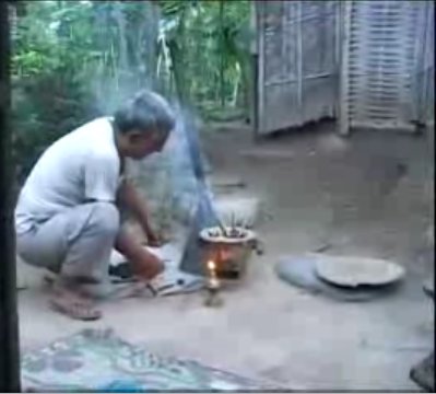 A Bhutanese refugee trying to set fire to cook food with the help of briquet  in a  refugee camp in Nepal. Refugees are provided with briquet as an alternative fuel.(photo:youtube