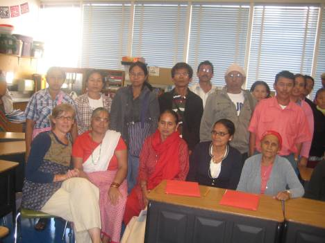 The elderly Bhutanese refugees with their Teacher