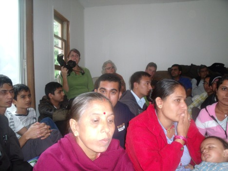 A local photo journalist listening to the speach read by Bhuwan Gautam for her which was delivered by Mr. Hari Khanal in her absance earlier