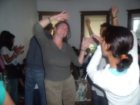 Bhutanese Youths Teaching Nepali Dance to a local women in the get together program