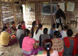 Refugee women learning English in Camp