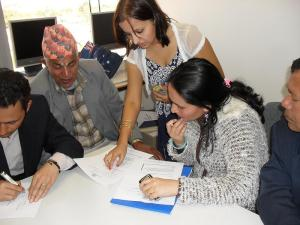 Miss Chaulagain with resettled Bhutanese at the program