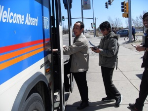 Three Bhutanese boarding homebound bus from DIA